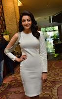 Beautiful Smiling Kajal Aggarwal in Creamy White Gown at MLA Telugu Movie Success Meet ~ .com Exclusive Pics 026.jpg