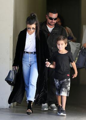 Kourtney-Kardashian-steps-up-her-secretary-team-with-a-personal-bodyguard-as-she-picks-up-her-son-Ma (1)