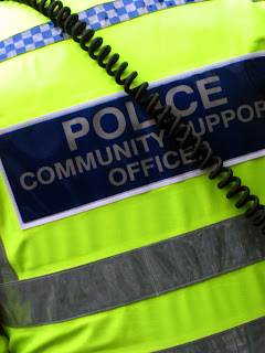 Photo of back of Police vest with Community Support Officer written on it.