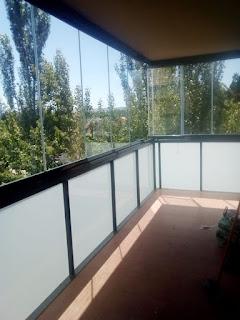 Instalación de cortina de cristal en Calatayud