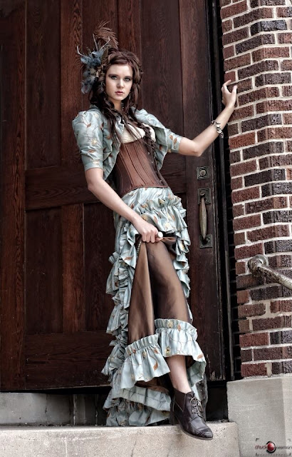 Women's steampunk fashion. Clothing includes corset, bolero jacket, skirt, fascinator and jewelry