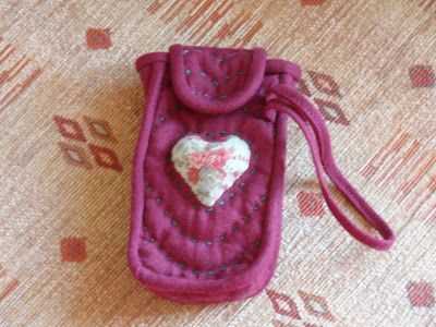 Applique Heart, and running stitch embroidered quilting...