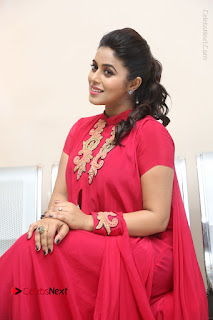 Actress Poorna Latest Stills in Red Dress at Rakshasi First Look Launch  0252.JPG