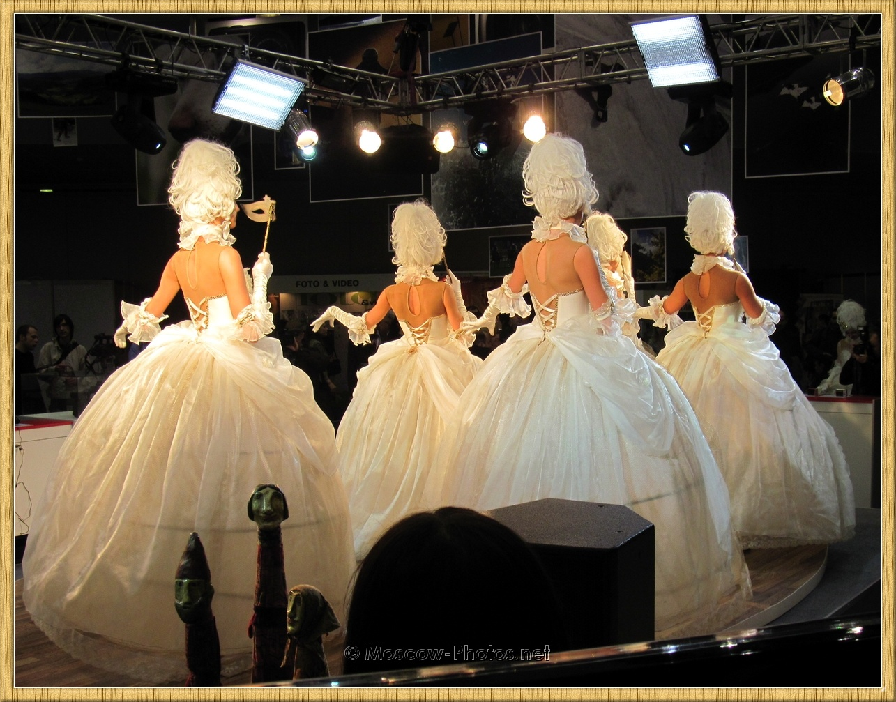 Girls dancing in white ball gowns