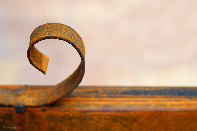 A Minimalistic Photograph of Curved Rusted Metal shot via Canon 600D DSLR Camera.