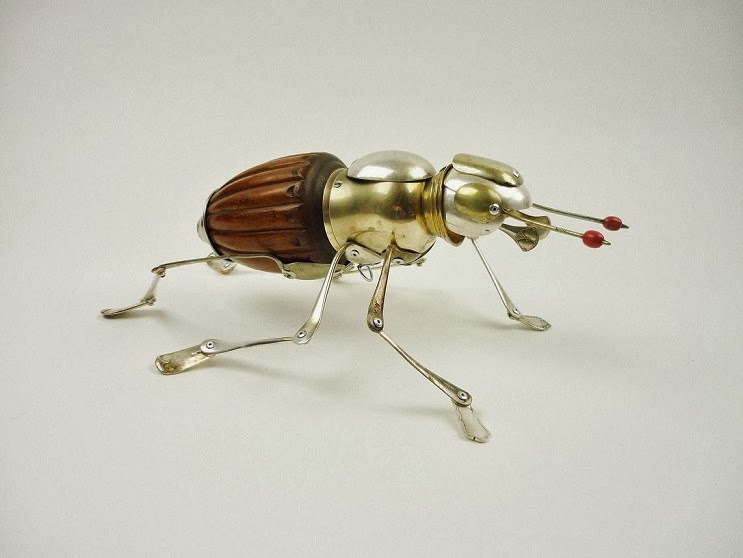08-Flower-Beetle-Sculptor-Recycled-Animal-Sculptures-Dean-Patman-Graphic-Design-www-designstack-co