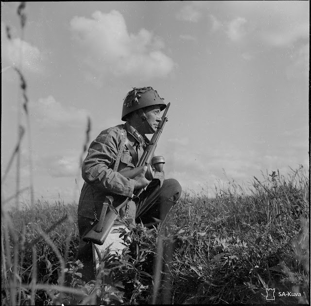 Finnish soldier with Carcano rifle, 1 August 1941 worldwartwo.filminspector.com