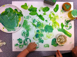 School painting stamping with tempera paint