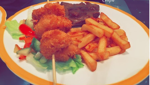 Coconut prawns, Steak, Salad, and Chips