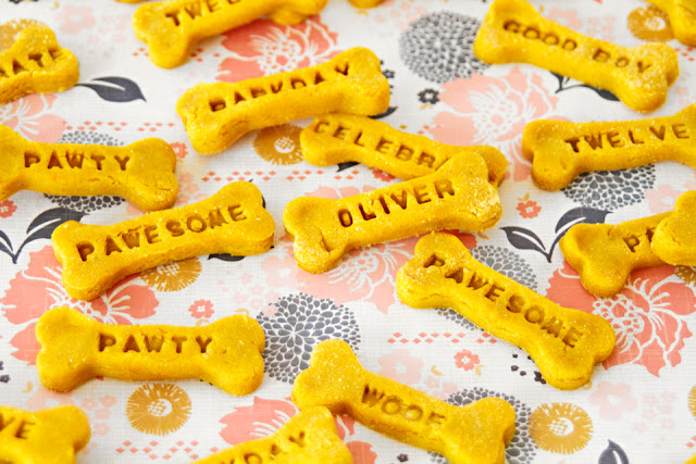 Bone shaped dog treats stamped with dog names and other words