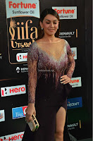 Hansika Motwani in Glittering Deep Neck Transparent Leg Split Purple Gown at IIFA Utsavam Awards 06.JPG