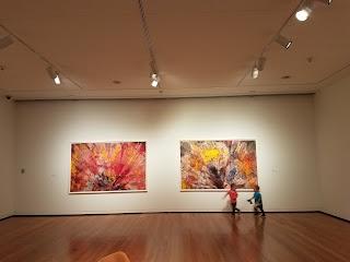 toddlers running through an art museum