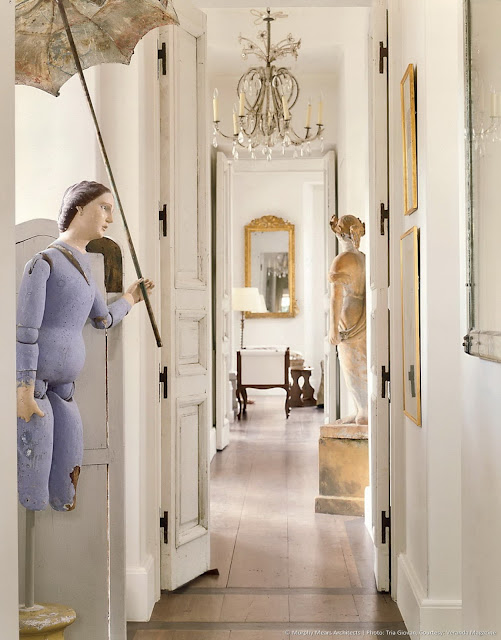 French country hallway with antique sculptures and doors by Eleanor Cummings