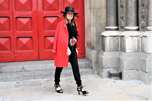 Looking on trend in red coat and bespoke hat, Hilda from Irish style blog Over the Hilda