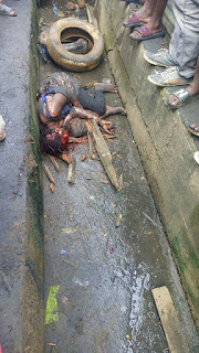 Female Kidnapper Caught In Ikorodu Beaten And Burnt To Death Today.