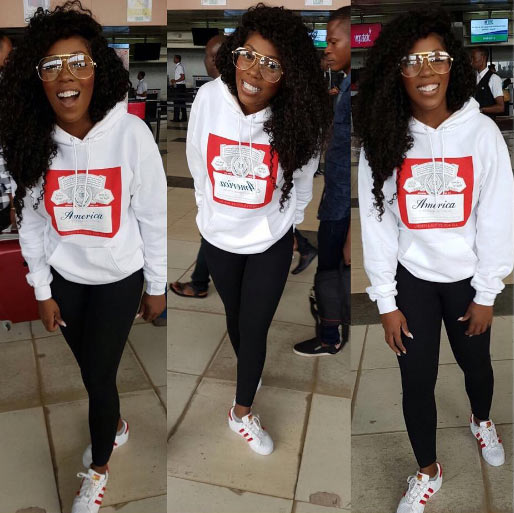 Tiwa Savage in tomboy outfit as she flies to London