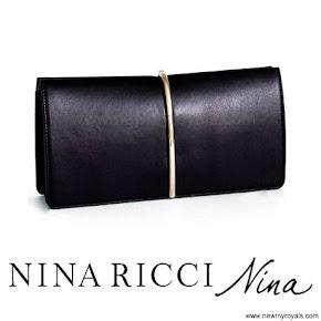 Queen Letizia carried Nina Ricci Arc Clutch