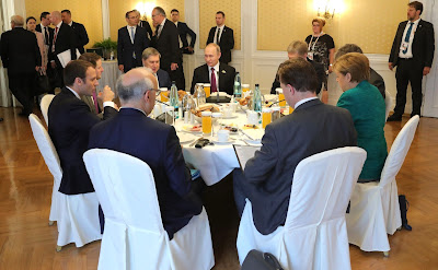 Vladimir Putin had a working breakfast with Federal Chancellor of Germany Angela Merkel and President of France Emmanuel Macron.