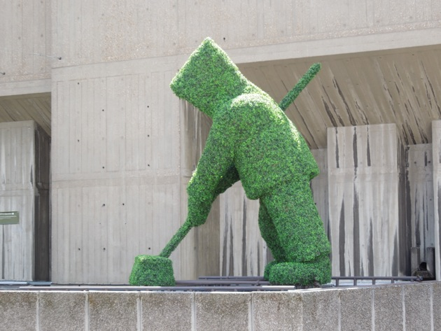 Rooftop topiary figure sweeping Southbank