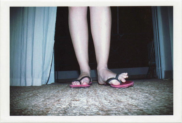 dirty photos - fumus - a photo of female toes wearing slippers