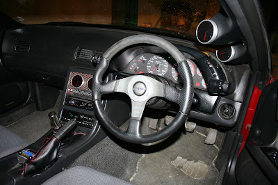 Custom Interior: 4 Defi gauges and Controller, pillar mounted, Veilside 340 km/h speedo, Momo Racing wheel, Nismo Shifter, Leather boots with Red Stitching