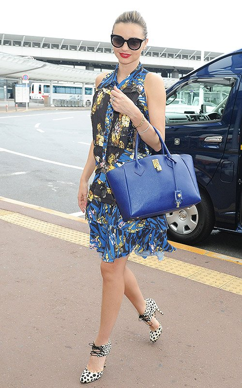 Miranda Kerr's airport fashion of an Alexander McQueen floral dress and leopard print heels