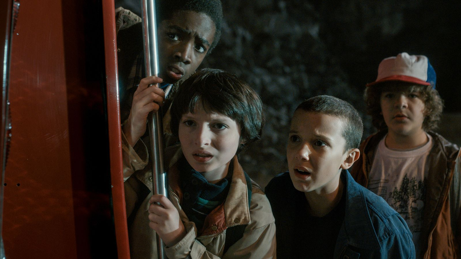 """In """"Stranger Things"""", Joyce Byers (Winona Ryder) lives in a small Indiana town in 1983. When Joyce's 12-year-old son, Will (Noah Schnapp), goes missing, ..."""