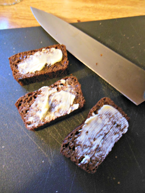 Heirloom Boston Brown Bread spread with creamy butter.