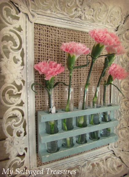 pink and turquoise hanging bud vases made from chemistry set parts