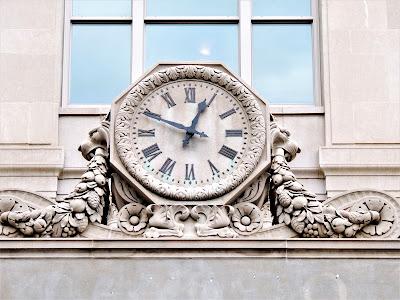 Clock on historic Texaco Building on San Jacinto Street