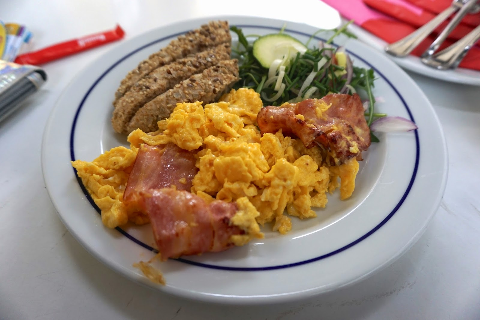 A brunch of scrambled eggs, bacon, toast and salad in Lisbon's Alfama district