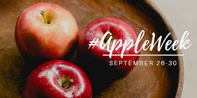 tray of apples with #appleweek logo and dates