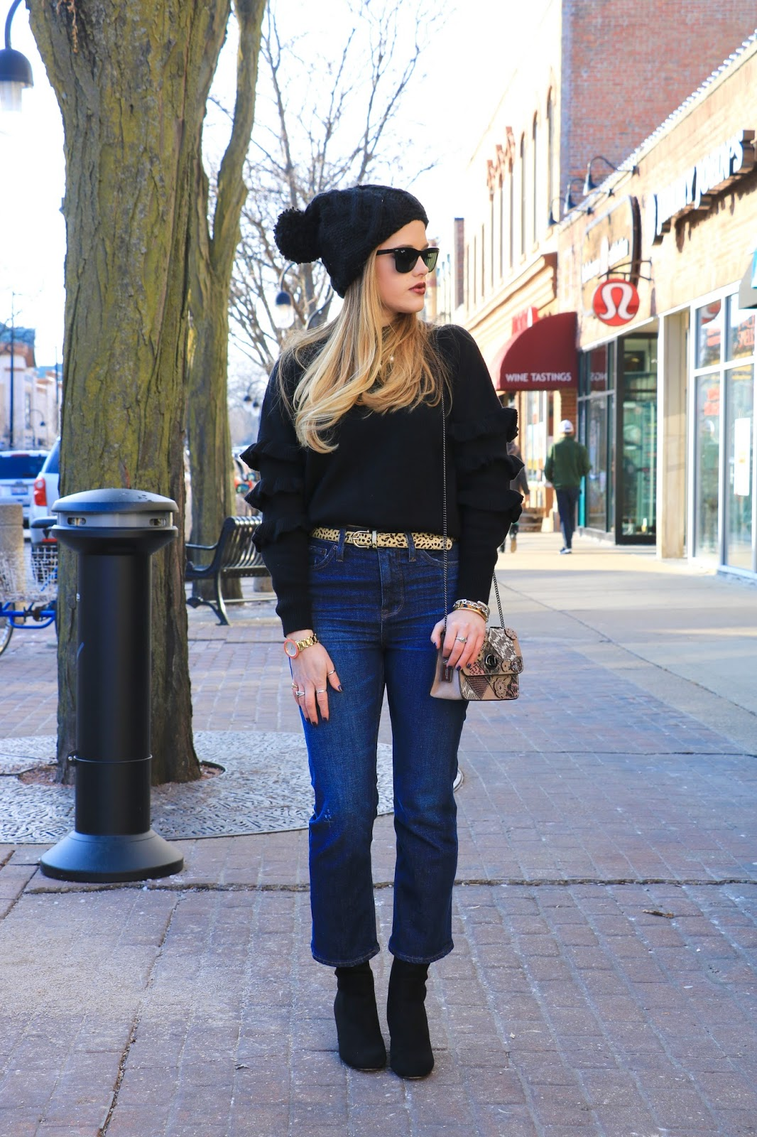 Nyc fashion blogger Kathleen Harper showing how to wear cropped flare jeans