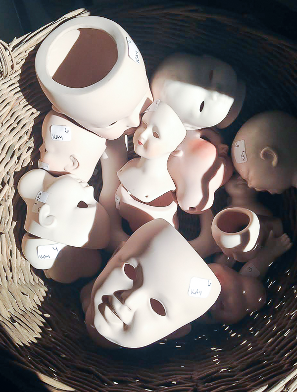 Porcelain baby heads