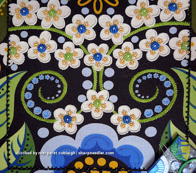 Several completed blue discs are shown. (Wild Child Japanese Bead Embroidery by Mary Alice Sinton)