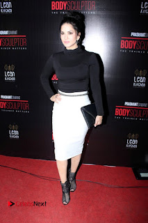 Bollywood Model Actress Sunny Leone Stills in White Skirt at Body Sculptor Gym Launch  0006.jpg