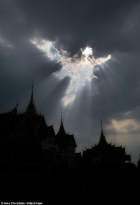 Angel in the clouds above Thai Buddhist temple