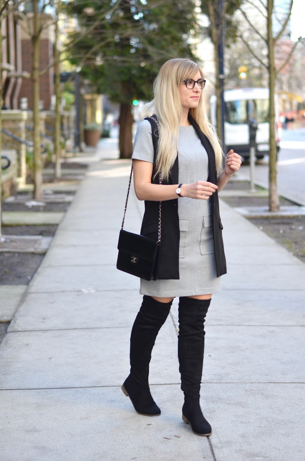 sleeveless blazer over a grey dress