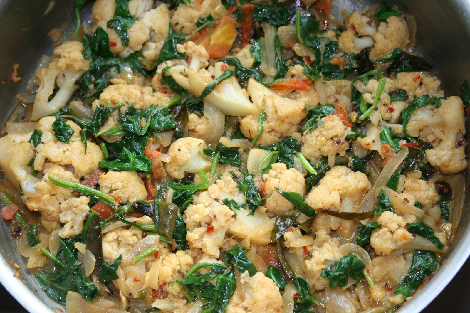 Aasai rasai sri lankan recipes tempered cauliflower with spinach add the spinach quickly turn off the heat toss the leaves around and take it off the hot stove immediately so as not to overcook the spinach forumfinder Image collections