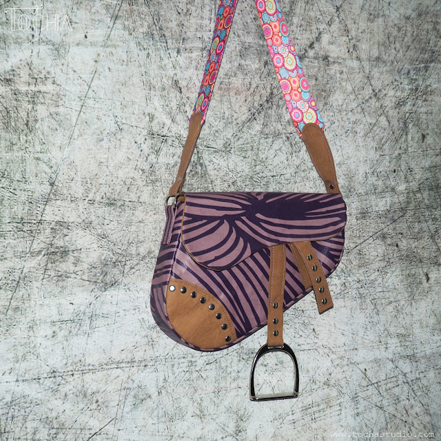 Dior, Justyna Anna Smółka, purse, saddle bag, vegan leather, washpapa, watercolours, Ujammaa Grandmas, John Galliano, HIV awareness, charity, guitar strap, purple, Pony Express