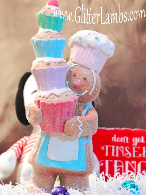 Gingerbread Boy Hobby Lobby Glitter Holding Stack of Cupcakes