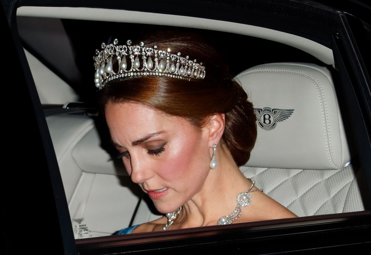 Kate wore the Cambridge Lover's Knot Tiara, previously owned by Diana, and an Alexander McQueen gown