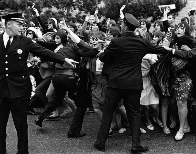 American policemen holding back young Rolling Stones fans in New York 1964. Pirate Radio and Sealand and Other stories of Rock, Radio, and Regulations. Marchmatron.com