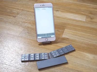 keyboard mungil dipasangkan ke hape