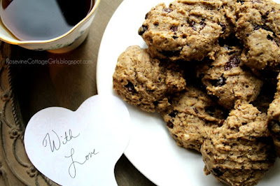 plate of cookies with chocolate pieces on white plate on a wooden tray with a cup fenugreek tea | rosevinecottagegirls.com