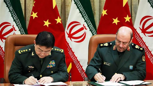 Image Attribute: Iranian Defense Minister Brigadier General Hossein Dehqan (R) and his Chinese counterpart General Chang Wanquan sign an agreement in Tehran on November 14, 2016 to boost defense-military cooperation and fight terrorism. (Photo by IRNA)
