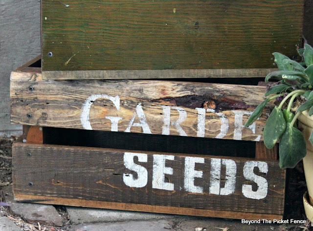 old sign stencils create a vintage crate made from reclaimed wood