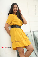 Actress Poojitha Stills in Yellow Short Dress at Darshakudu Movie Teaser Launch .COM 0113.JPG