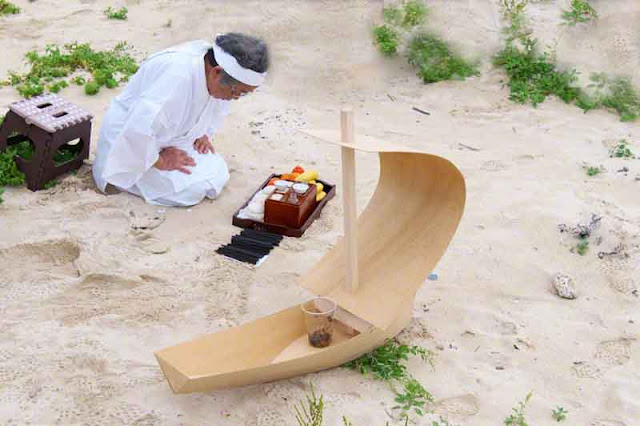Priestess isolated, praying, miniature wooden sailboat, offerings