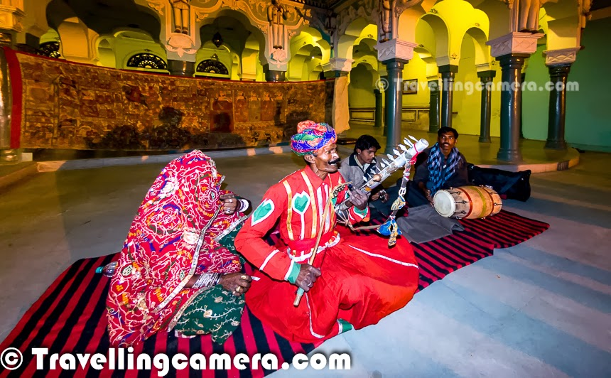 """The second memory is of us enjoying an evening full of music and good snacks at the hotel. The hotel owner, Deepak Balan, had invited some local folk artists to perform Pabuji ki Phad. The Phad is a religious scroll extolling the antics of Pabuji, a folk-deity who lived in the 14th century. While singing Pabuji ki Phad, this scroll is displayed in the background. The company that performed for us consisted of an old man with handlebar mustache, a middle-aged woman, who sang most of the songs but kept her face covered throughout, and a bright-eyed little boy dressed in traditional Rajasthani attire who did most of the dancing. Some of us joined him in the dance. It was a truly wonderful experience. Deepak had also invited a local historian to come and speak to us about the history of Churu. I don't remember much of the talk except a little trivia about the historical site we now call """"Mohenjodaro"""". Apparently, its actual name is """"Moinjo dharo"""", which means mountain of dead bodies. I don't know why none of the history of Churu stuck, but this fact simply won't fade."""